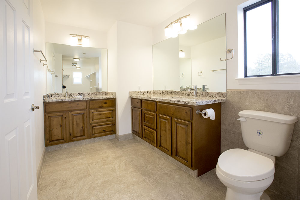 New Master Bathroom with granite counters and Rustic Tuscany style cabinets