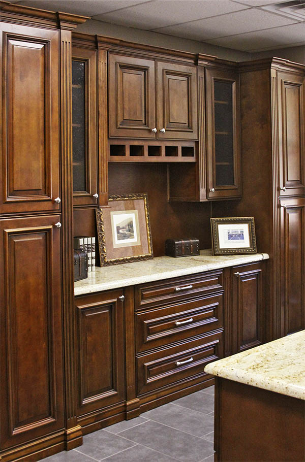 Office cabinets by Sollid Cabinetry in the Sedona door style and Walnut finish