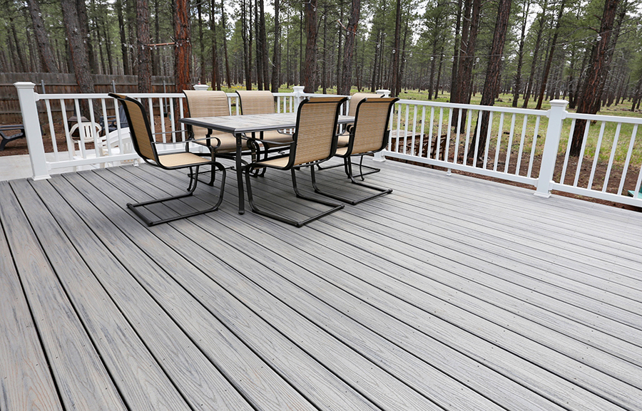 Trex Transcends Decking in Island Mist color with Trex Select White Handrails for a deck in Flagstaff AZ