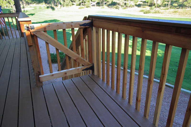 Trex deck with Redwood handrails and gate