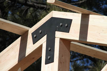 Closeup of custom steel brackets for large beam connections on deck cover job in Flagstaff Arizona