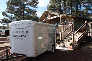 Carpentry tool trailer for Highwood Construction and Remodeling in front of deck cover job