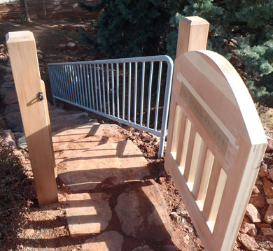 Redwood gate with welded iron rail in Sedona
