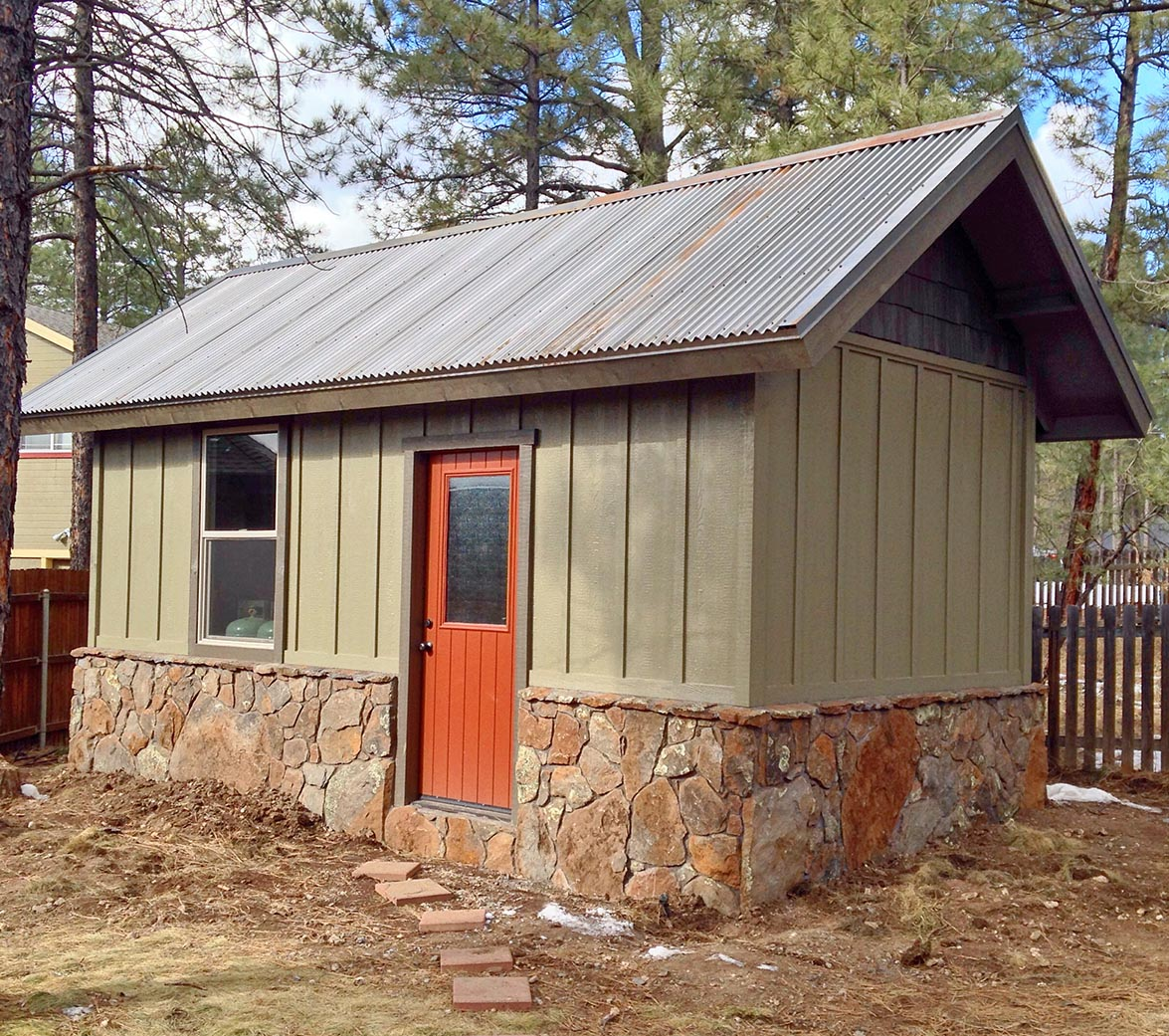 Custom workshop by Highwood construction with a core-ten metal roof.