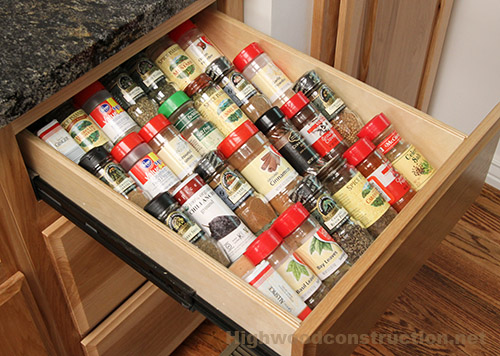 Kitchen spice drawer in hickory cabinets