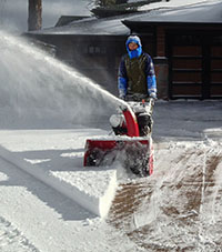 snow blowing a driveway in Flagstaff Arizona