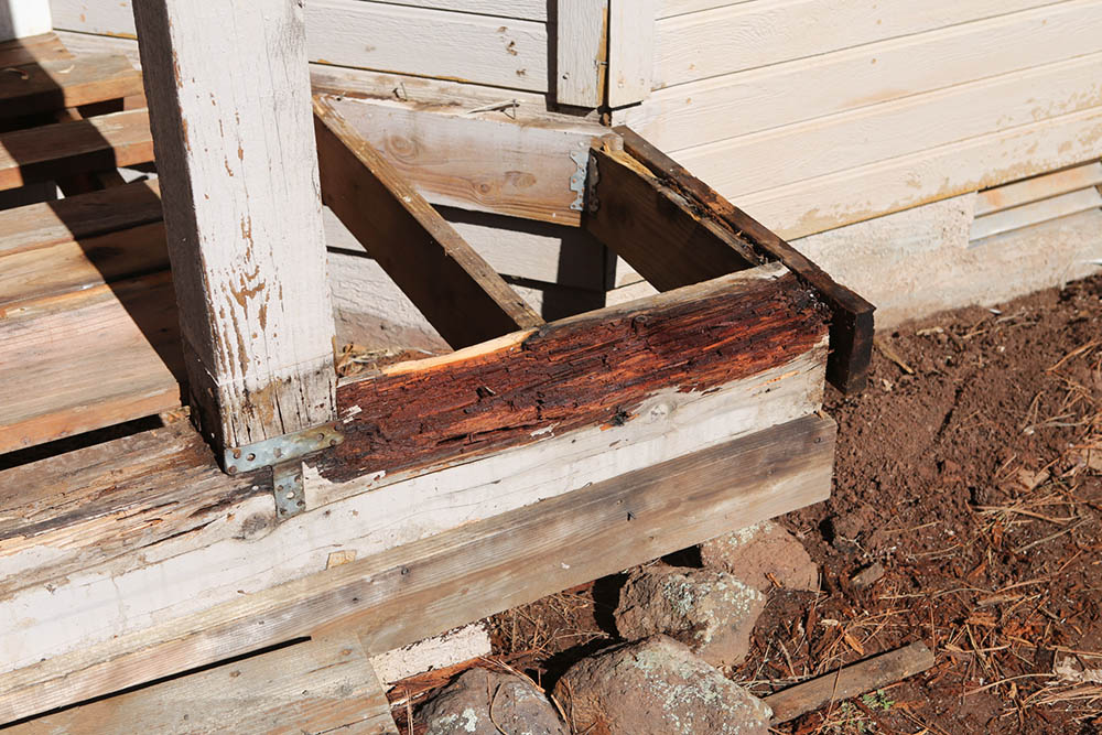 A deck in Flagstaff damaged by water dripping off of the roof above.