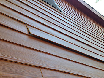 improperly installed hardi-plank lap siding by 'the other guys'
